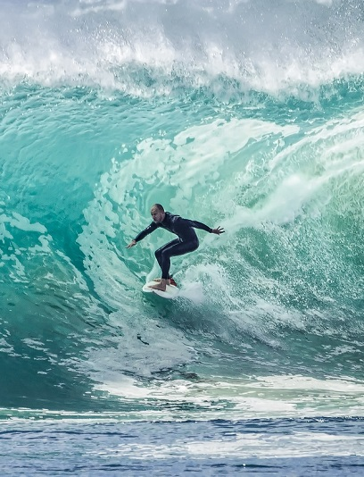 pexels surfing big wave
